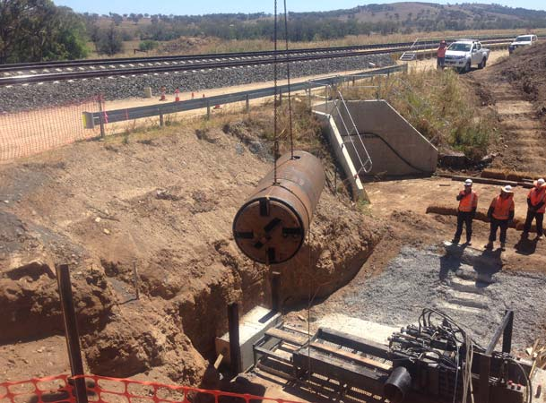 Pezzimenti microtunneling Auger being lowered down to the jacking frame