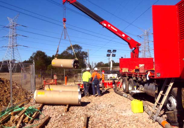 Mount Druitt Microtunneling Craning Pipes to the shaft