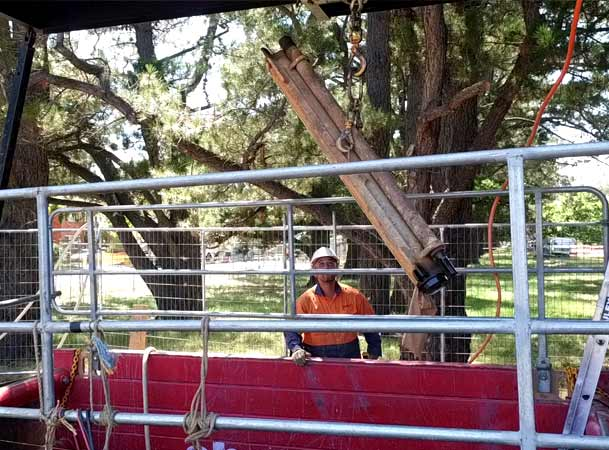 Downer ACT Pezzimenti Microtunneling Top Man Cranes drill rods into shaft