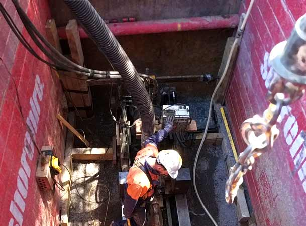 Downer ACT Pezzimenti Microtunneling Loading drill rods