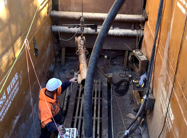Menangle Pezzimenti Tunnelbore Lowering Drill Rod to Jacking Frame